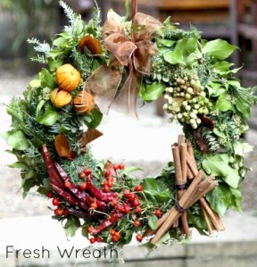 fresh-wreaths-orange-and-berries, chilis, cinnamon, bay leaves. wreath, holiday, fall. eventandpartyideas.com